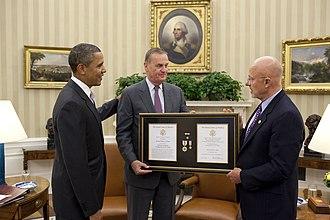 James Clapper - Clapper and Barack Obama presented the NIDSM to James L. Jones, October 20, 2010