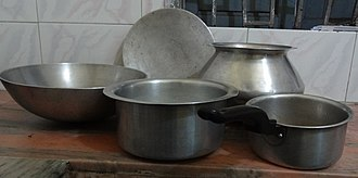 Bengali cuisine - Different utensils used in a Bengali household. Clockwise from left: korai, tawa, hari, tea pan and a dekchi/deg.
