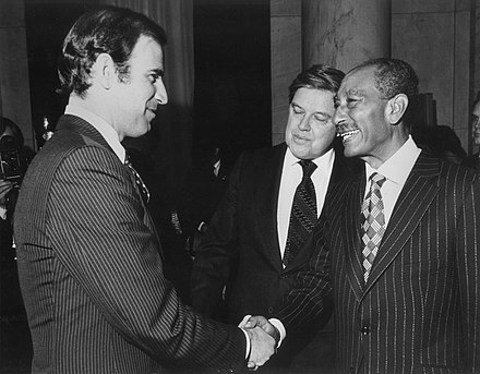 Senator Biden, Senator Frank Church and President of Egypt Anwar el-Sadat after signing Egyptian-Israeli Peace Treaty, 1979 Biden-Church-Sadat.jpg