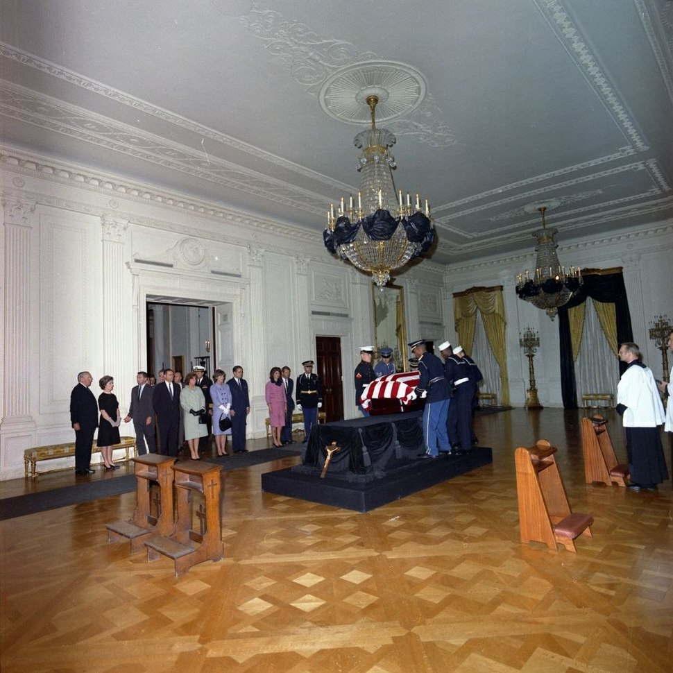 Body of JFK being placed on catafalque in East Room.jpg