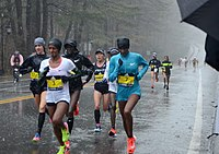 Lead women ear halfway point of Boston Marathon 2018 during an especially hard down pour.