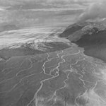 Brady Glacier, outwash plain in the foreground and the terminus of valley glacier in the midground, September 16, 1972 (GLACIERS 5591).jpg
