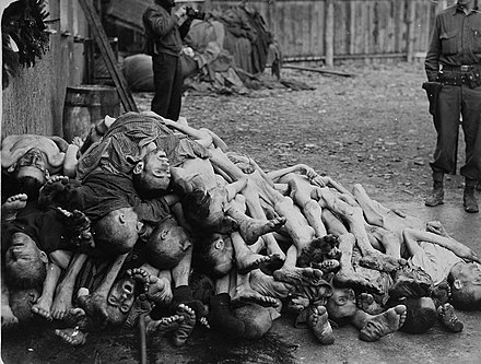 American soldiers view a pile of corpses found in the newly liberated Buchenwald concentration camp in April 1945 Buchenwald Corpses 07511.jpg