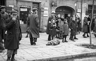 Jewish ghettos in German-occupied Poland - A child lies on the street in the Warsaw Ghetto, May 1941. Photo by the Wehrmacht Propaganda Company 689, now in German Federal Archives