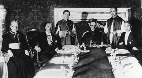 Pacelli (seated, center) at the signing of the Reichskonkordat on 20 July 1933 in Rome with (from left to right): German prelate Ludwig Kaas, German Vice-Chancellor Franz von Papen, Secretary of Extraordinary Ecclesiastical Affairs Giuseppe Pizzardo, Alfredo Ottaviani, and Reich minister Rudolf Buttmann Bundesarchiv Bild 183-R24391, Konkordatsunterzeichnung in Rom.jpg