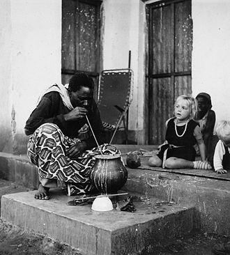 Millet beer - A man drinking pombe on the porch of Bonno Thoden van Velzen (Ibala village, 1967).