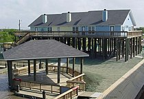 Cabins at Beach at Cypremort Point State Park.jpg