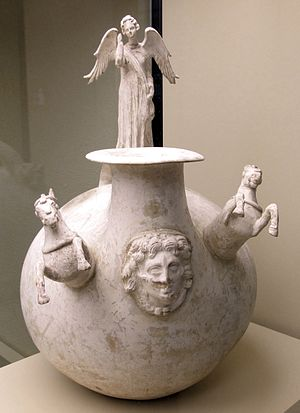 Canosa di Puglia - A Greek pottery askos from Canosa di Puglia, depicting goddess Nike, the head of Medusa, and horses, 3rd century BC