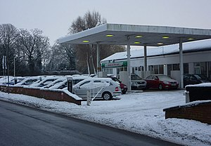English: Car dealership Snow covered cars for sale in Woolpit. By the turn into the village from the A14..