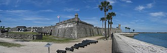 Florida - The Castillo de San Marcos. Originally white with red corners, its design reflects the colors and shapes of the Cross of Burgundy and the subsequent Flag of Florida.
