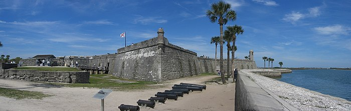 The Castillo de San Marcos. Originally white with red corners, its design reflects the colors and shapes of the Cross of Burgundy and the subsequent Flag of Florida. Castillo de San Marcos Fort Panorama 1.jpg