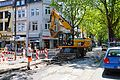 Caterpillar M318D + man at work. Spielvogel.jpg