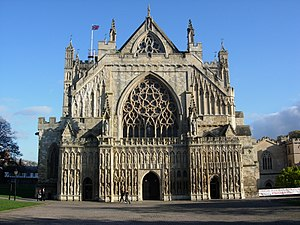 Aedicula - Gothic facade of Exeter Cathedral, with rows of figures in aedicular or tabernacle frames above the door, and two above the crenellations