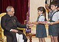 Children tying 'Rakhi' to the President, Shri Pranab Mukherjee, on the occasion of 'Raksha Bandhan', in New Delhi on August 10, 2014 (1).jpg