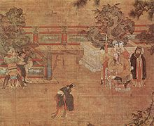 A painting of a play being staged in a courtyard. In the center, a man in loose black robes appears in mid-bow or mid-dance. To the left, two men dressed as guards are holding a third man, dressed in the same attire as the man in the center. To the right, a heavy set man sits in a throne. Behind him stand three women in white face paint and a man dressed in the same attire as the man in the center.