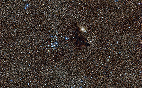 Cluster NGC 6520 and the strangely shaped dark cloud Barnard 86.jpg