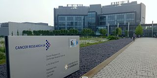 The photo shows the entrance of one of the Cancer Research UK buildings