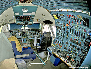 Flight engineer - The cockpit of a non-operational four-engine Ilyushin Il-86, with its flight engineer's station at right