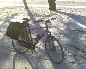 Cold-weather biking - A bicycle set up for winter commuting with metal-studded tires, an enclosed chain case, and enclosed drum brakes.