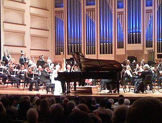 Piano concerto - Performance of a piano concerto involves a piano on stage with the orchestra