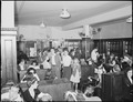 Crowd of miners and families in soda fountain prior to movie showing Saturday night. Inland Steel Company... - NARA - 541424.tif