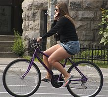 Cycling woman wearing miniskirt.jpg