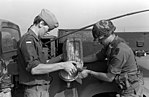 DA-SN-84-11415 Soldier of 66th Maintenance Company, helps a German soldier refuel a truck for Carbine Fortress, a NATO exercise 1982.jpeg