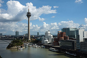 Neuer Zollhof - The Media Harbor with Rheinturm telecommunications tower (left) and the three Neuer Zollhof buildings (right)