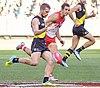 Dan Butler kicking (cropped).jpg