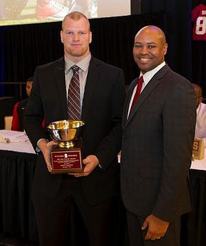 Trent Murphy - Stanford head coach David Shaw presenting Murphy with the Jack Huston Award in 2012