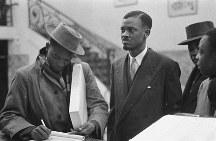 Patrice Lumumba, leader of the MNC-L and first Prime Minister, pictured in Brussels at the Round Table Conference of 1960 De Congolese leider Patrice Loemoemba in Brussel, Bestanddeelnr 910-9741.jpg