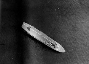 HMS Hermes (95) - Aerial view of SS Mamari III disguised as Hermes with a false flight deck and island
