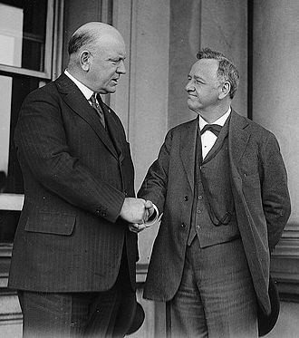 Josephus Daniels - Daniels (right) shaking hands with his successor as Secretary of the Navy, Edwin Denby.