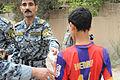 Distribution of candy and toys in Beladiyat DVIDS166392.jpg