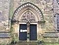 Doorway of St Cuthbert's, Durham.jpg