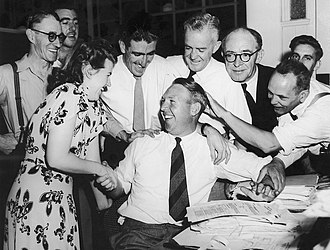 Doug Ring - Doug Ring is congratulated by his colleagues at the Melbourne Department of Commerce on 25 February 1948 after being selected to tour England.
