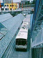 Dual-mode bus at Convention Place station on DSTT first day, 9-15-1990.jpg