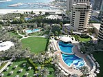 Dubai Marina and surrounding gardens from a tower room of Le Royal Méridien Beach Resort and Spa, Dubai Marina, Dubai, United Arab Emirates.
