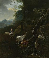 A sheperdess with her flock in a mountainous landscape