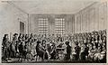 Elizabeth Fry is seated at a table in a large room surrounde Wellcome V0041200.jpg