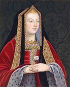 A blond woman with rosy cheeks holds a white rose. She wears a gilded black shawl over her head and a red robe trimmed in white spotted fur.