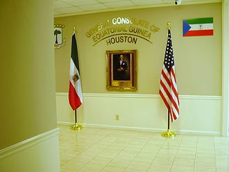 Politics of Equatorial Guinea - A politician's image appears in the entrance to the Consulate-General of Equatorial Guinea in Houston, a diplomatic complex in an office building in Houston, Texas, United States