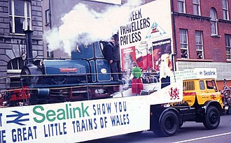 Sealink - Ffestiniog Railway locomotive Britomart being hauled by a British Rail Bedford TK tractor unit, with a Sealink promotion of the Great Little Trains of Wales, during the St Patrick's Day Parade in 1974 in Dublin.