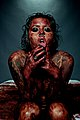 Female model posing while covered with mock blood.jpg