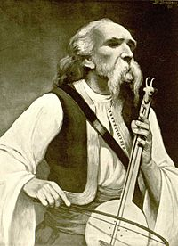 Moustachioed man playing a one-stringed instrument