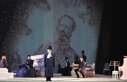 The final scene of the opera Risorgimento! (2011) by Lorenzo Ferrero. Verdi, one of the characters in the opera, stands just left of centre. Final scene from the opera Risorgimento!.jpg