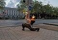 Fire staff street performer in Brussels (DSC 4101).jpg
