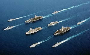 A rare occurrence of a 5-country multinational fleet, during Operation Enduring Freedom in the Oman Sea. In four descending columns, from left to right: MM Maestrale (F 570), De Grasse (D 612); USS John C. Stennis (CVN 74), Charles De Gaulle (R 91), Surcouf (F 711); USS Port Royal (CG-73), HMS Ocean (L 12), USS John F. Kennedy (CV 67), HNLMS Van Amstel (F 831); and ITS Luigi Durand de la Penne (D 560).