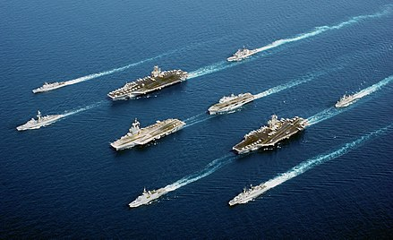 Four modern aircraft carriers of various types; USS John C. Stennis (United States Navy), Charles de Gaulle (French Navy), USS John F. Kennedy (US Navy), HMS Ocean (Royal Navy) and escort vessels, 2002