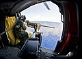 Flickr - Official U.S. Navy Imagery - A helicopter crewman fires a .50-caliber machine gun..jpg